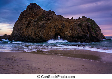 The Keyhole Rock at sunset, at Pfeiffer Beach, in Big Sur,...