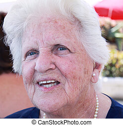 smiling portrait of an old woman - smiling portrait of a...