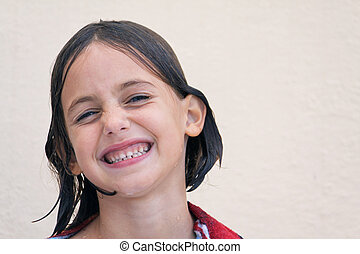 wet child with cheesy grin - caucasian child with cheesy...
