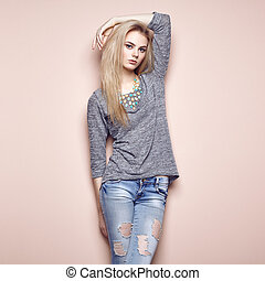 Fashion portrait of beautiful young woman with blond hair