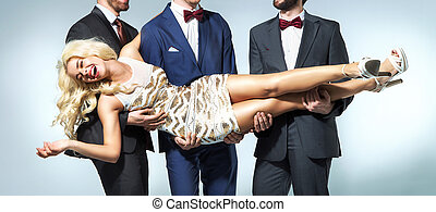 Blond woman carried by three handsome men