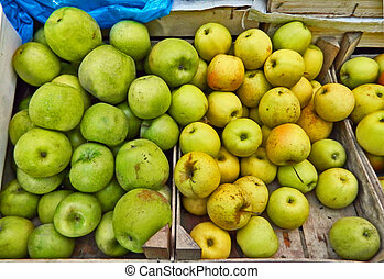 Green yellow apples market - Green and yellow apples at the...