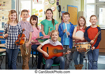Portrait Of Students Playing In School Orchestra Together