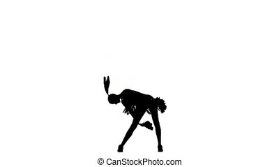 Young cheerleader with pom-poms smiling at camera. Silhoutte...