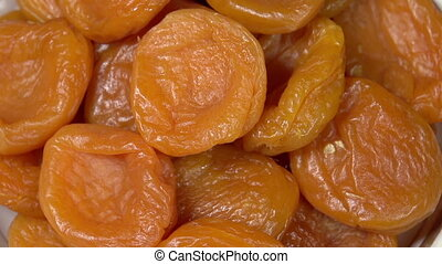 Bright Dried Apricots - Front of the camera rotates plate...