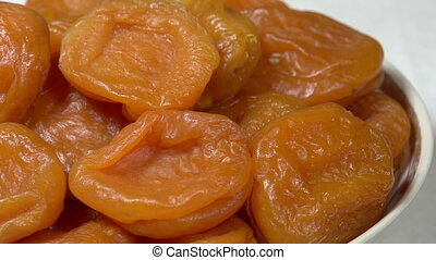 Bright Dried Apricots on a Plate - Front of the camera...