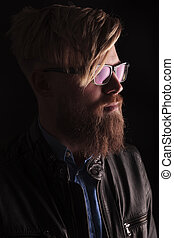 blond hipster man wearing glasses - Close up portrait of a...