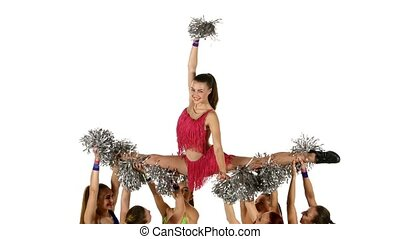 Girls in multicolored suits with pompons doing splits on...