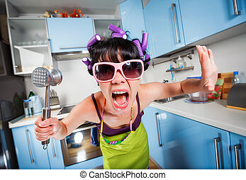 Crazy housewife in an interior of the kitchen Family...