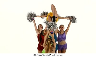 Group of beautiful girls dancing. Cheerleading. pompons, Close up