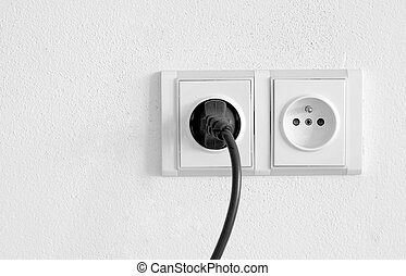 Power outlet - European power outlet with black cord plugged...