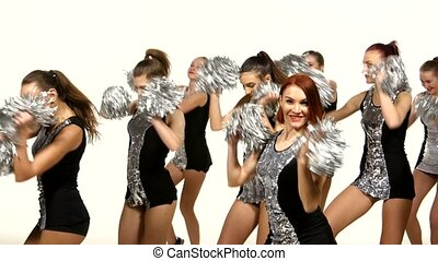 Beautiful dancing girls: cheerleading, pom-poms in hand,...