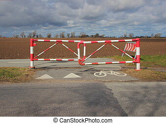 Bicycle Safety Barrier in Stripes and Bike Sign on Rural Road