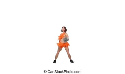 beautiful girl cheerleader dances on a white background with pompoms, slow motion