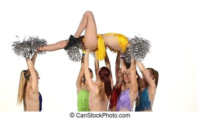 Group of beautiful girls dancing. Cheerleading. pompons, slow motion