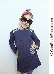 Self-confident little girl posing for her dad - Exquisitely...