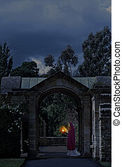 Lady in castle garden at night - Lady with a lantern in...