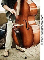 Double bass performer - Street artist performing double bass