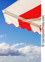 Awning over bright blue sky