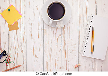 Open Notepad.and cup of coffee with post-it note on white...
