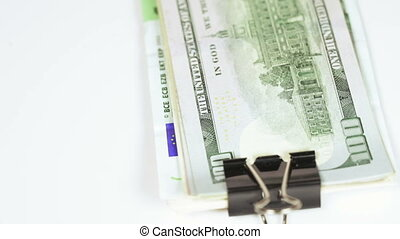 Stack dollars with clip - On rotating table stack of dollars...