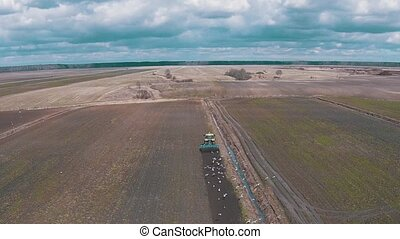 Tractor Plowing the Field, aerial shot