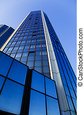 High skyscraper from below over clear blue sky