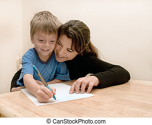 Mother and son have fun doing homework.