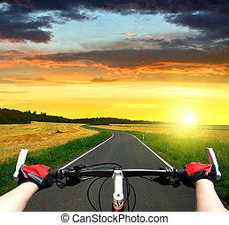 Cyclist riding a bike in the sunset