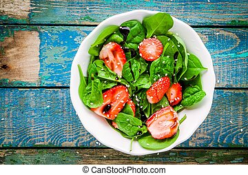 salad with fresh spinach and strawberries with balsamic...
