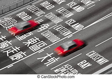Hong Kong Taxis - Red Hong Kong Taxis on a busy interchange...