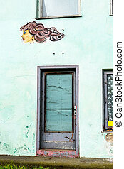woman faces on a house wall