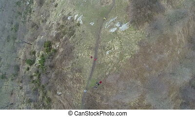 Aerial view of cross country race participants running on...