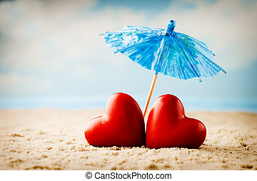 Heart on the sand on the seashore. - Greeting card just...