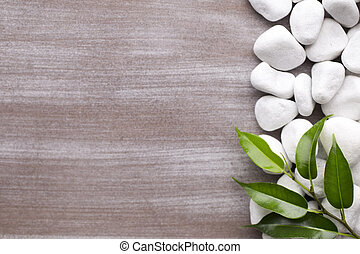 Spa backgroud. - White pebble stone frame and leaf....