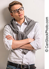 Male - Handsome smiling man in casual wear on grey...