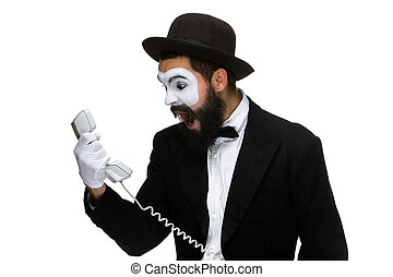 angry and irritated man screams into the telephone receiver...