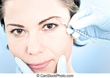 botox injection - Beautiful woman receiving a botox...