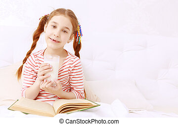 Read-haired girl drinking milk and reading - Sweet child...