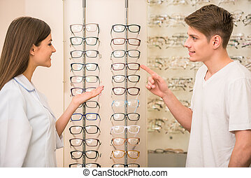 Oprician store - Optical store, client man and professional...