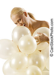 biting ballons - pretty young blond woman with balloons in...