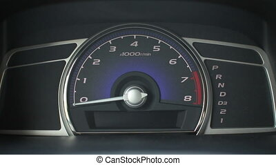 tachometer on the dashboard of a car - tachometer on the...