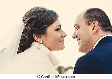 Happy bride and groom on their wedding day in a park. Bridal...
