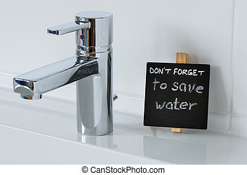 Reminder to save water in the bathroom Detail shot of the...