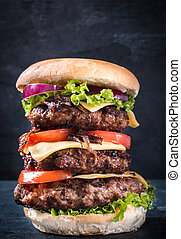 Triple burger - Triple beef burger with cheese and grilled...