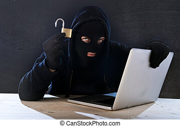dangerous hacker man with computer and lock hacking system...