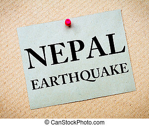 NEPAL EARTHQUAKE Note. Recycled paper note pinned on cork...