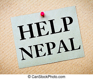 HELP NEPAL Note. Recycled paper note pinned on cork board....