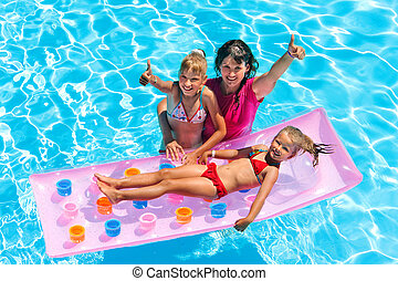 Family in swimming pool - Family with children in swimming...