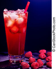 Red raspberry cocktail on dark background. - Red raspberry...